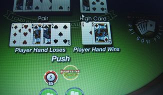 In this Jan. 31, 2014 photo, a computer screen in Atlantic City, N.J., shows a game of Pai Gow underway on a gambling website. A new Fairleigh Dickinson University PublicMind poll released Monday, Feb. 3, 2014, finds more New Jerseyans would rather smoke pot than gamble over the Internet. (AP Photo/Wayne Parry)
