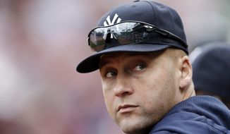 FILE - in a Sept. 14, 2013 file photo, New York Yankees' Derek Jeter  looks on from the dugout during their 5-1 loss to the Boston Red Sox in a baseball game at Fenway Park in Boston. Jeter has taken on-field batting practice for the first time since his 2013 season was cut short by injuries, on Monday, Feb. 3, 2014. Jeter hit with authority to all fields during a five-round, 39-swing session Monday at the Yankees' minor league complex. Jeter also took grounders at shortstop for the first time this year, fielding 34 balls at his usual position. (AP Photo/Winslow Townson, File)