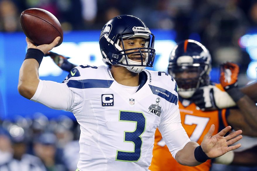 Seattle Seahawks' Russell Wilson throws against the Seattle Seahawks during the second half of the NFL Super Bowl XLVIII football game Sunday, Feb. 2, 2014, in East Rutherford, N.J. (AP Photo/Paul Sancya)