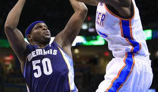 Memphis Grizzlies forward Zach Randolph (50) shoots as Oklahoma City Thunder forward Serge Ibaka (9) defends during the second quarter of an NBA basketball game on Monday, Feb. 3, 2014, in Oklahoma City. (AP Photo/Alonzo Adams)