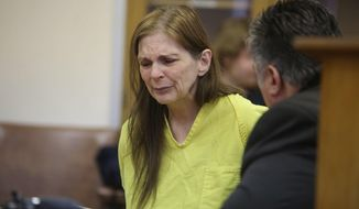 Donna Kay Scrivo appears for arraignment before being charged with the disinterment of her son Ramsay Scivo , on Monday Feb, 3, 2014, at 40th District Court in St. Clair Shores, Mich.    (AP Photo/Detroit Free Press, Andre J. Jackson)  DETROIT NEWS OUT;  NO SALES