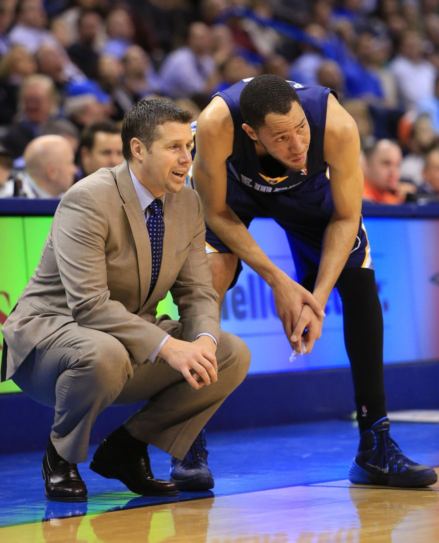 Memphis Grizzlies head coach David Joerger talks to Tayshaun Prince (21) during the second quarter of an NBA basketball game against the Oklahoma City Thunder on Monday, Feb. 3, 2014, in Oklahoma City. (AP Photo/Alonzo Adams)