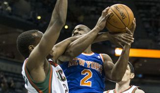 Milwaukee Bucks' Khris Middleton tries to stop New York Knicks' Raymond Felton from shooting the ball during the first half of an NBA basketball game, Monday, Feb. 3, 2014, in Milwaukee. (AP Photo/Tom Lynn)