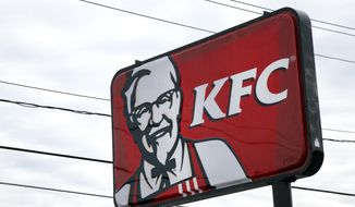 In this  Friday, Jan. 31, 2014, photo, a KFC sign hangs in Saugus, Mass. Fast-food conglomerate Yum! Brands, Inc., headquartered in Louisville, Ky., will report its fourth-quarter and annual earnings on Monday after markets close. (AP Photo/Elise Amendola)