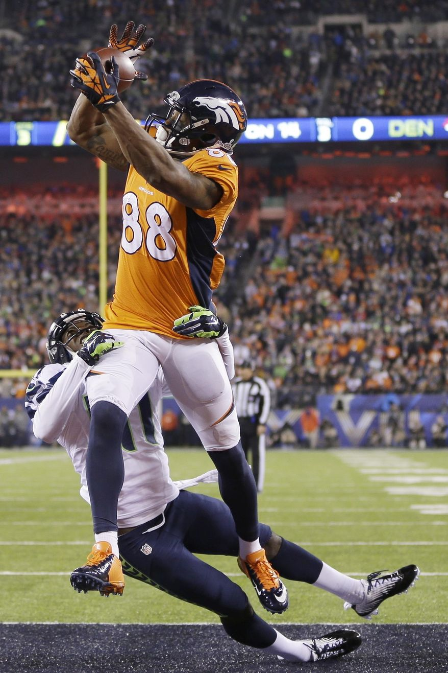 Denver Broncos' Demaryius Thomas catches a pass for a touchdown while covered by Seattle Seahawks' Byron Maxwell during the second half of the NFL Super Bowl XLVIII football game Sunday, Feb. 2, 2014, in East Rutherford, N.J. (AP Photo/Mark Humphrey)