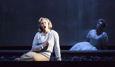 """In this undated photo provided by the Houston Grand Opera, Melody Moore as Marta, left, and Michelle Breedt as Liese, perform during a dress rehearsal of the opera, """"The Passenger,"""" in Houston. """"The Passenger"""" is the darkest of operas, a powerful and unrelentingly grim work that dares to grapple with the horrors of the Holocaust through a musical descent into Auschwitz. (AP Photo/Houston Grand Opera, Lynn Lane)"""
