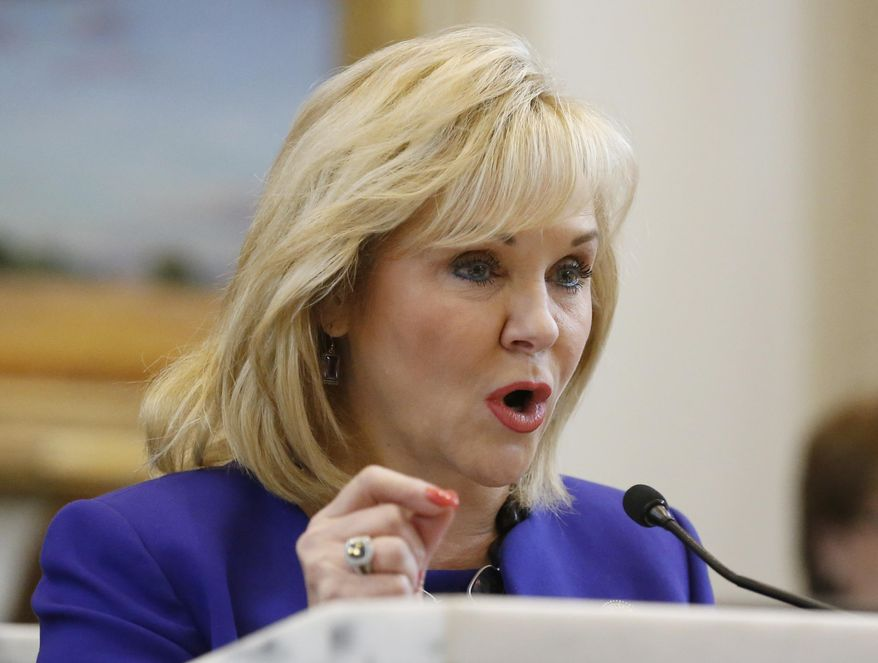 Oklahoma Governor Mary Fallin gestures as she speaks during her fourth State of the State address in Oklahoma City, Monday, Feb. 3, 2014. Fallin renewed her call for a cut in the state's income tax rate and asked legislators to approve a bond issue to help repair the state Capitol. (AP Photo/Sue Ogrocki)