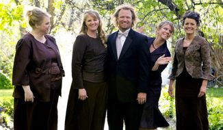 """FILE - In this undated file photo provided by TLC, Kody Brown, center, poses with his wives, from left, Janelle, Christine, Meri, and Robyn in a promotional photo for TLC's reality TV show, """"Sister Wives.""""   A lawmaker who says Utah should avoid legislating morality wants to change the law to comply with a federal judge's ruling striking down key parts of the state's polygamy laws. (AP Photo/TLC, Bryant Livingston, File)"""