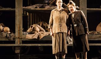 "In this undated photo provided by the Houston Grand Opera, Melody Moore as Marta, left, and Michelle Breedt as Liese, perform during a dress rehearsal of the opera, ""The Passenger,"" in Houston. ""The Passenger"" is the darkest of operas, a powerful and unrelentingly grim work that dares to grapple with the horrors of the Holocaust through a musical descent into Auschwitz. (AP Photo/Houston Grand Opera, Lynn Lane)"