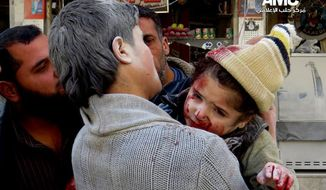 This photo provided by the anti-government activist group Aleppo Media Center (AMC), which has been authenticated based on its contents and other AP reporting, shows a Syrian man carrying a wounded child following a Syrian government airstrike in Aleppo, Syria, Monday, Feb. 3, 2013. Syrian government helicopters and warplanes unleashed a wave of airstrikes on more than a dozen opposition-held neighborhoods in the northern city of Aleppo on Sunday, firing missiles and dropping crude barrel bombs in a ferocious attack that killed at least 36 people, including children, activists said. (AP Photo/Aleppo Media Center, AMC)