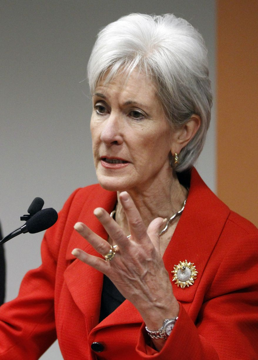 Health and Human Services Secretary Kathleen Sebelius, left, speaks at a news conference on enrollment in affordable health coverage in Cleveland Monday, Feb. 3, 2014. Sebelius pointed to in-person assistance available in the Cleveland area to help people choose and enroll in affordable coverage options in the Health Insurance Marketplace. (AP Photo/Mark Duncan)