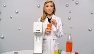 """This undated frame grab provided by SodaStream, shows the company's 2014 Super Bowl commercial. SodaStream's ad features """"Her"""" actress Scarlett Johansson promoting its at-home soda maker and will run in the fourth quarter. The ad, which promotes the product as a healthier and less wasteful way to make soda, made waves ahead of the game when the company said it would delete its last line, """"Sorry, Coke and Pepsi,"""" at a request by Fox. (AP Photo/SodaStream)"""