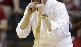 Michigan head coach John Beilein signals to his team as they play Indiana in the second half of an NCAA college basketball game in Bloomington, Ind., Sunday, Feb. 2, 2014. Indiana defeated Michigan 63-52. (AP Photo/Michael Conroy)