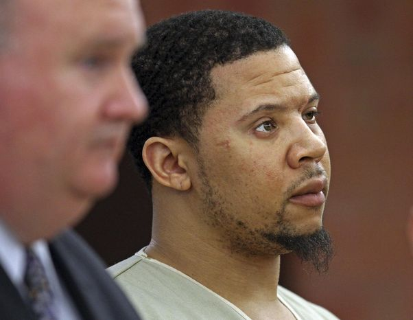 Alexander Bradley, an associate of former New England Patriots football player Aaron Hernandez, stands with his attorney Robert Pickering, left, during arraignment on weapons charges Tuesday, Feb. 4, 2014, in Superior Court in Hartford, Conn. Bradley was shot in the leg outside a Hartford nightclub Sunday night, where police said he returned gunfire. Bradley alleges he was shot in the face by Hernandez in Florida last year. (AP Photo/Boston Herald, Nancy Lane , Pool)