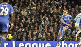 Chelsea's Branislav Ivanovic, right, scores the first goal of the game for his side during their English Premier League soccer match against Manchester City at the Etihad stadium in Manchester, England, Monday Feb. 3, 2014. (AP Photo/Clint Hughes)