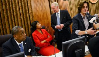 D.C. Council members (from left) Vincent B. Orange, Muriel Boswer, Jack Evans and Mary M. Cheh gather Tuesday before a spirited debate over marijuana laws. By the end of the session, a watered-down decriminalization bill had been approved. (Andrew Harnik/The Washington Times)
