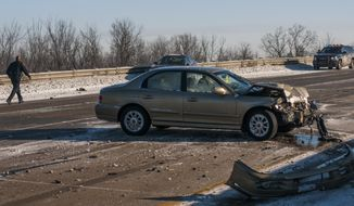 A car rests in the middle of the road on westbound Interstate 69 on the city's east side after police shut down roads due to icy conditions, Monday, Feb. 3, 2014 in Flint, Mich. (AP Photo/The Flint Journal, Jake May) LOCAL TV OUT; LOCAL INTERNET OUT