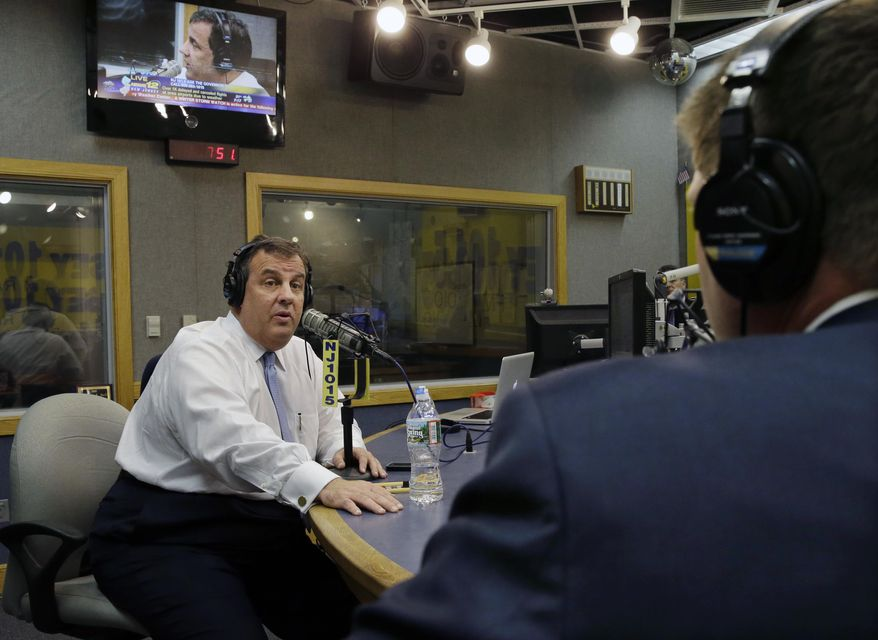 """New Jersey Gov. Chris Christie sits in a studio during his radio program, """"Ask the Governor""""  broadcast on NJ 101.5, Monday, Feb. 3, 2014, in Ewing, N.J. During the program, Christie took questions from callers for the first time in more than three weeks as his campaign looked for a way to pay for lawyers as a political payback scandal continues. (AP Photo/Mel Evans, Pool)"""