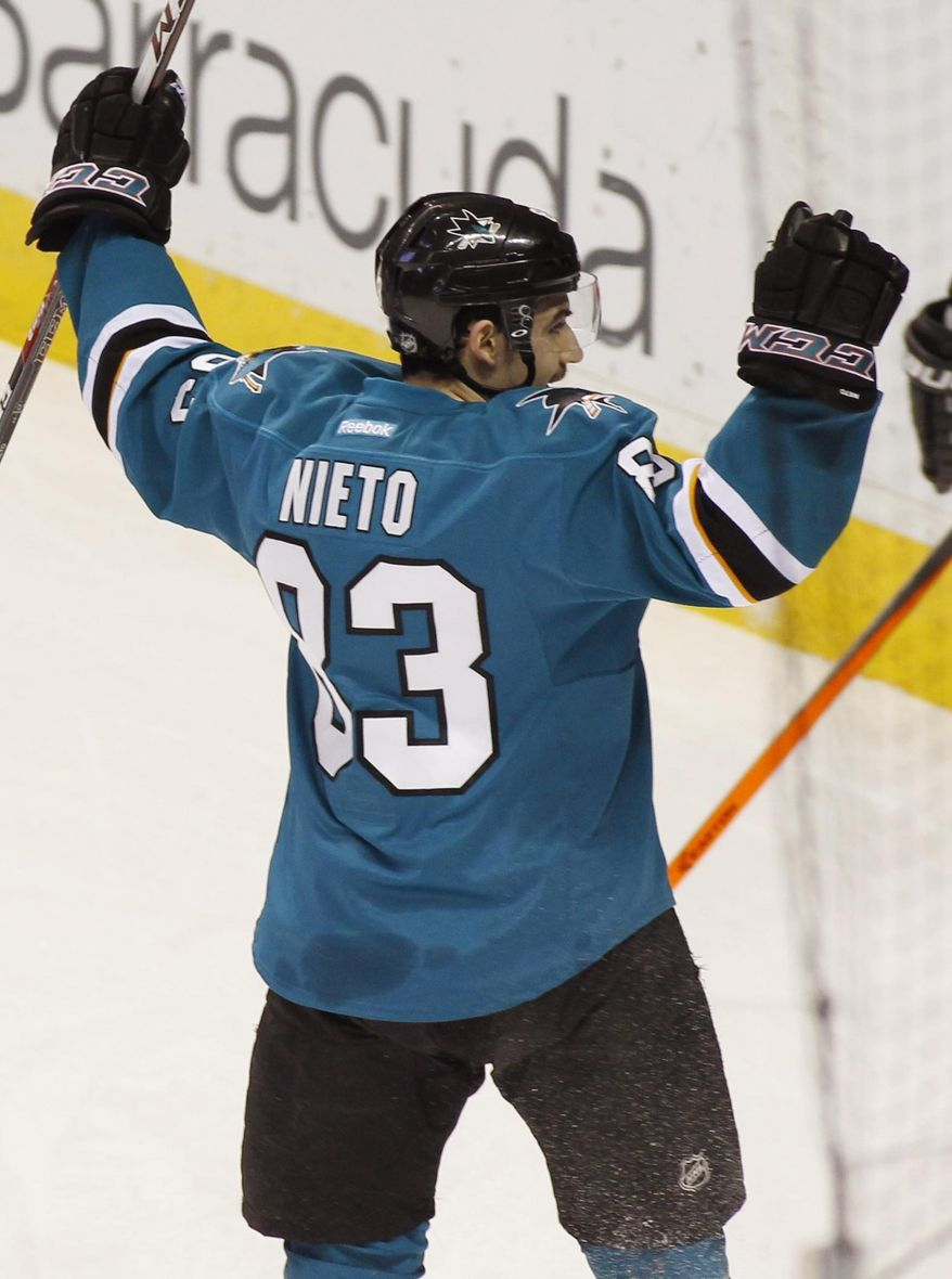 San Jose Sharks' Matt Nieto raises his hands after scoring against the Philadelphia Flyers during the first period of an NHL hockey game, Monday, Feb. 3, 2014, in San Jose, Calif. (AP Photo/George Nikitin)