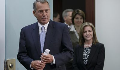 House Speaker John Boehner of Ohio, left, followed by Rep. Lynn Jenkins, R-Kansas, and  Rep. Cathy McMorris Rodgers, R-Wash., and House Majority Whip Kevin McCarthy of Calif., arrives to speak to reporters about the Keystone XL Pipeline and other issues, following a Republican Conference meeting, Tuesday, Feb. 4, 2014, on Capitol Hill in Washington. (AP Photo/J. Scott Applewhite)
