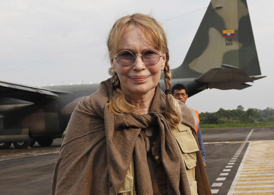 FILE - This Jan. 28, 2014 file photo shows U.S. actress Mia Farrow at Lago Agrio airport, before she flies to the Aguarico field in the Ecuadorean Amazonia region, Aguarico, Ecuador. Dylan Farrow, the adopted daughter of Woody Allen and Mia Farrow, penned an emotional open letter, accusing Hollywood of callously lionizing Allen, who she claims abused her. The letter revived in stunning detail an allegation more than two decades old. (AP Photo/Dolores Ochoa, File)