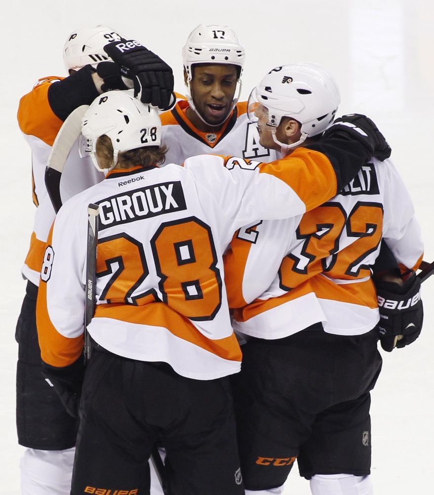Philadelphia Flyers' Wayne Simmonds, celebrates with teammates, from left, Jakub Voracek, Claude Giroux (28) and Mark Streit (32) after scoring against the San Jose Sharks during the first period of an NHL hockey game, Monday, Feb. 3, 2014, in San Jose, Calif. (AP Photo/George Nikitin)