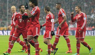 Munich teammates celebrate after scoring during the German first division Bundesliga soccer match between Bayern Munich and Eintracht Frankfurt in Munich, Germany, Sunday, Feb. 2, 2014. (AP Photo/Frank Augstein)