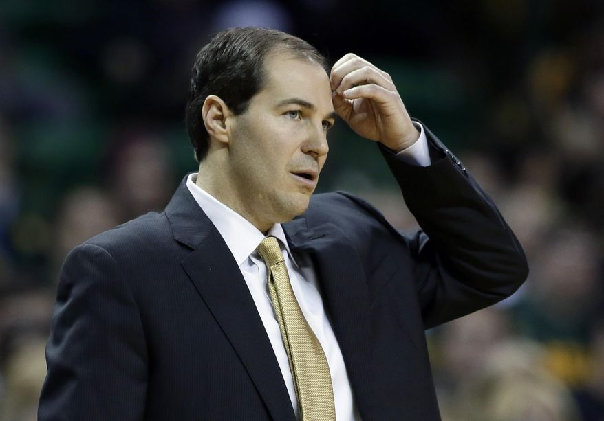 Baylor head coach Scott Drew watches from the sideline in the first half of an NCAA college basketball game against Kansas, Tuesday, Feb. 4, 2014, in Waco, Texas. Kansas won 69-52. (AP Photo/Tony Gutierrez)