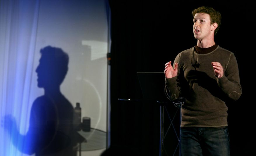 FILE - In this Monday, Nov. 6, 2007, file photo, Facebook CEO Mark Zuckerberg speaks to press and advertising partners at a Facebook announcement in New York. On Feb. 4, 2014, Facebook celebrates 10 years since Mark Zuckerberg created a website called Thefacebook.com to let his classmates find their friends online. (AP Photo/Craig Ruttle, File)