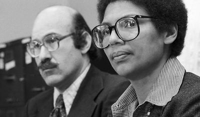 FILE - In this April 24, 1980, file photo, Olympic bronze medalist Anita DeFrantz, right, and Ira Glasser, executive director of the American Civil Liberties Union, announce a lawsuit in New York by athletes against the U.S. Olympic Committee for depriving Americans the opportunity to compete in the Moscow Games. The American rower missed out on the 1980 Moscow Olympics because of the U.S.-led boycott. Now, after all those years, DeFrantz is in Russia for an Olympics. Not as a competitor, but as the highest-ranking American in the international Olympic world. (AP Photo/Burnett, File)
