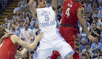North Carolina's Marcus Paige (5) drives to the basket against Maryland's Seth Allen (4) during the first half  of an NCAA basketball game, Tuesday, Feb. 4, 2014 at the Smith Center in Chapel Hill, N.C. (AP Photo/The News & Observer, Robert Willett)
