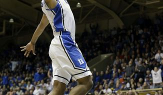 Duke's Jabari Parker drives to the basket for a dunk against Wake Forest during the first half of an NCAA college basketball game in Durham, N.C., Tuesday, Feb. 4, 2014. (AP Photo/Gerry Broome)