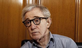 "FILE - In this Dec. 29, 2011 file photo, Woody Allen, director of the film, ""Midnight in Paris,"" is photographed during an interview in Beverly Hills, Calif.  Dylan Farrow, the adopted daughter of Allen and Mia Farrow, penned an emotional open letter, accusing Hollywood of callously lionizing Allen, who she claims abused her. The letter revived in stunning detail an allegation more than two decades old. (AP Photo/Matt Sayles, File)"