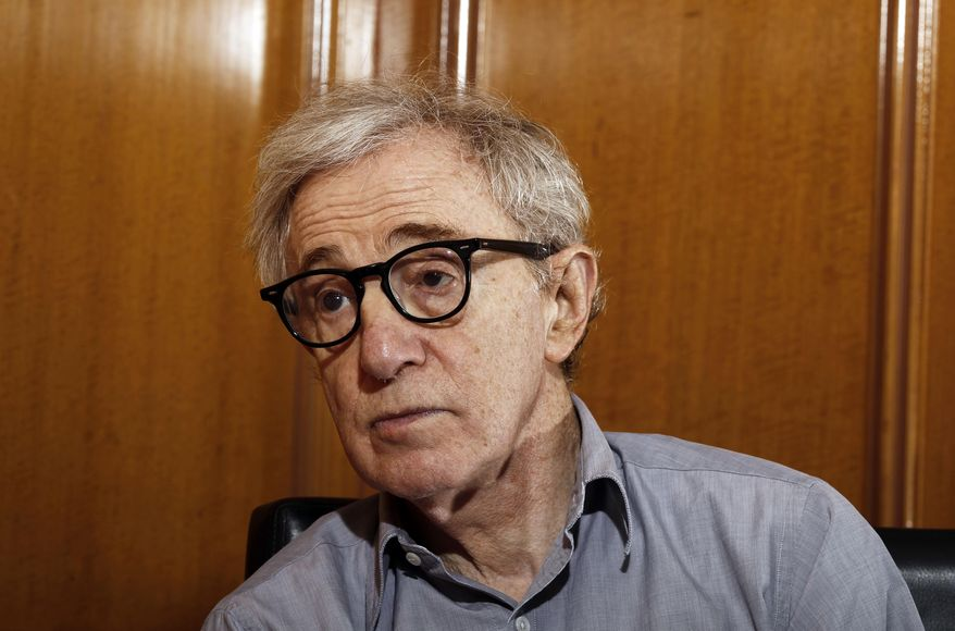 """FILE - In this Dec. 29, 2011 file photo, Woody Allen, director of the film, """"Midnight in Paris,"""" is photographed during an interview in Beverly Hills, Calif.  Dylan Farrow, the adopted daughter of Allen and Mia Farrow, penned an emotional open letter, accusing Hollywood of callously lionizing Allen, who she claims abused her. The letter revived in stunning detail an allegation more than two decades old. (AP Photo/Matt Sayles, File)"""