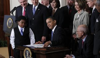 ** FILE ** In this March 23, 2010, file photo, President Barack Obama reaches for a pen to sign the health care bill in the East Room of the White House in Washington. (AP Photo/Charles Dharapak, File)