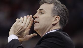 American University's head coach Mike Brennan instructs his team against Ohio State during the first half of an NCAA college basketball game on Wednesday, Nov. 20, 2013, in Columbus, Ohio. (AP Photo/Jay LaPrete) **FILE**