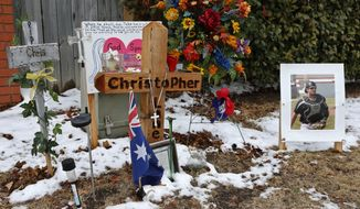 Snow dots the ground at the site of a memorial to Australian Christopher Lane who was shot and killed in Duncan, Okla., in August of 2013, on the day of a hearing for three suspects in the case, in Duncan, Okla, Tuesday, Feb. 4, 2014. (AP Photo/Sue Ogrocki)