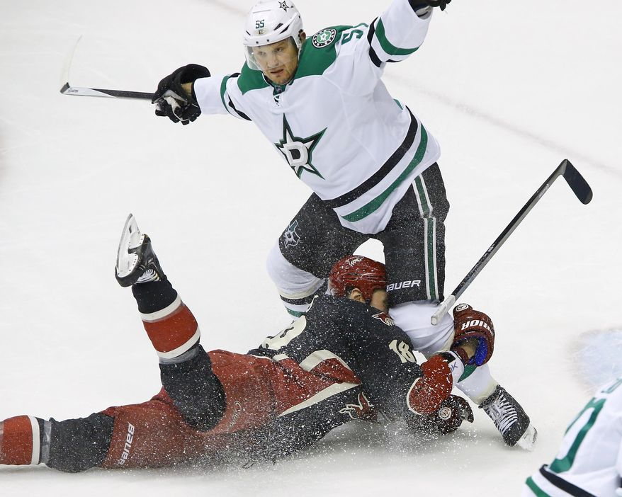 Phoenix Coyotes right wing David Moss (18) is pulled down by Dallas Stars defenseman Sergei Gonchar (55) during the second period of their NHL hockey game, Tuesday, Feb. 4, 2014 in Glendale, Ariz. (AP Photo/The Arizona Republic, David Kadlubowski)