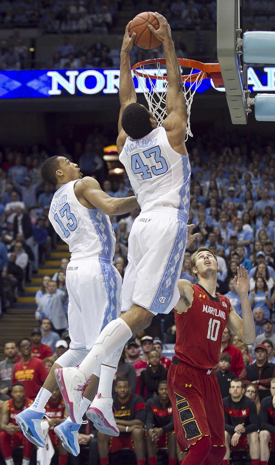North Carolina's James Michael McAdoo (43) dunks on Maryland's Jake Layman (10) during the first half  of an NCAA basketball game, Tuesday, Feb. 4, 2014 at the Smith Center in Chapel Hill, N.C. (AP Photo/The News & Observer, Robert Willett)