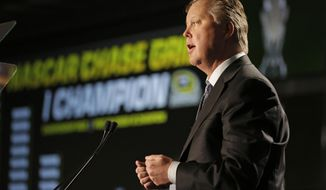 NASCAR CEO Brian France talks to the media about the new points system during a news conference at the NASCAR Sprint Cup auto racing Media Tour in Charlotte, N.C., Thursday, Jan. 30, 2014. (AP Photo)