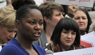 Pamela Tarver, title loan borrower, speaks at a Montgomery, Ala. rally concerning predatory lending legislation on Feb. 4, 2014. (AP PHOTO/AL.com, Julie Bennett)