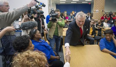 Georgia Governor Nathan Deal greets cafeteria workers during a visit to Westlake High School to thank faculty and staff for keeping students safe during last week's snow storm, Tuesday, Feb. 4, 2014, in Atlanta. According to the principal 450 people were stranded at the school during the storm. (AP Photo/John Amis)
