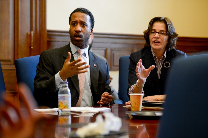 Councilmembers Kenyan McDuffie (D- Ward 5), left, and Mary Cheh (D-Ward 3), right, speak during a breakfast meeting before a Committee of the Whole Meeting at the Wilson Building, Washington, D.C., Tuesday, February 4, 2014. (Andrew Harnik/The Washington Times) **FILE**