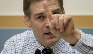 House Judiciary Committee member Rep. Jim Jordan, R-Ohio questions Deputy Attorney General James Cole on Capitol Hill in Washington, Tuesday, Feb. 4, 2014, during the committee's hearing on Examining Recommendations to Reform FISA Authorities. (AP Photo/Cliff Owen)