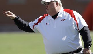 FILE - In this Oct. 18, 2008 file photo, Maryland coach Ralph Friedgen yells from the sidelines during the first half of an NCAA college football game against Wake Forest in College Park, Md. Friedgen was recently hired as the offensive coordinate at Rutgers. (AP Photo/Rob Carr, File)