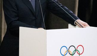 Russian President Vladimir Putin speaks at the opening of the 126th session of the International Olympic Committee, at the Zimny Theater, ahead of the 2014 Winter Olympics, Tuesday, Feb. 4, 2014, in Sochi, Russia. (AP Photo/Pavel Golovkin)