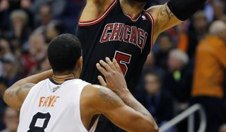 Chicago Bulls' Carlos Boozer (5) shoots over Phoenix Suns' Channing Frye (8) during the first half of an NBA basketball game, Tuesday, Feb. 4, 2014, in Phoenix. (AP Photo/Matt York)