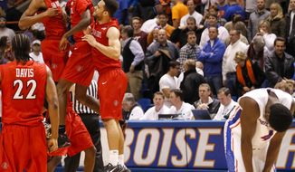 San Diego State celebrates their win over Boise State after an NCAA college basketball game in Boise, Idaho, Wednesday, Feb. 5, 2014. San Diego State won 67-65. (AP Photo/Otto Kitsinger)