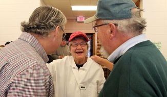 FOR RELEASE SATURDAY, FEB. 8, 2014, AT 12:01 A.M. CST. AND THEREAFTER - In this Jan. 25, 2014 photo, Ceil Deprey, center, greets visitors to Ceil's Meal at First Congregational Church in Sheboygan, Wis. About four times a year, on the fifth Saturday of the month, First Congregational Church, UCC welcomes the public to a free breakfast, called Ceil's Meal. (AP Photo/The Sheboygan Press, Gary C. Klein)