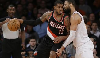 New York Knicks' Tyson Chandler (6) defends Portland Trail Blazers' LaMarcus Aldridge (12) during the first half of an NBA basketball game Wednesday, Feb. 5, 2014, in New York. (AP Photo/Frank Franklin II)